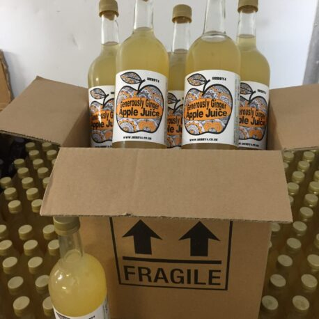 six 750ml bottles of Generously Ginger apple juice