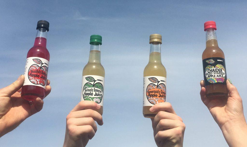 Herby4 apple juice against blue sky